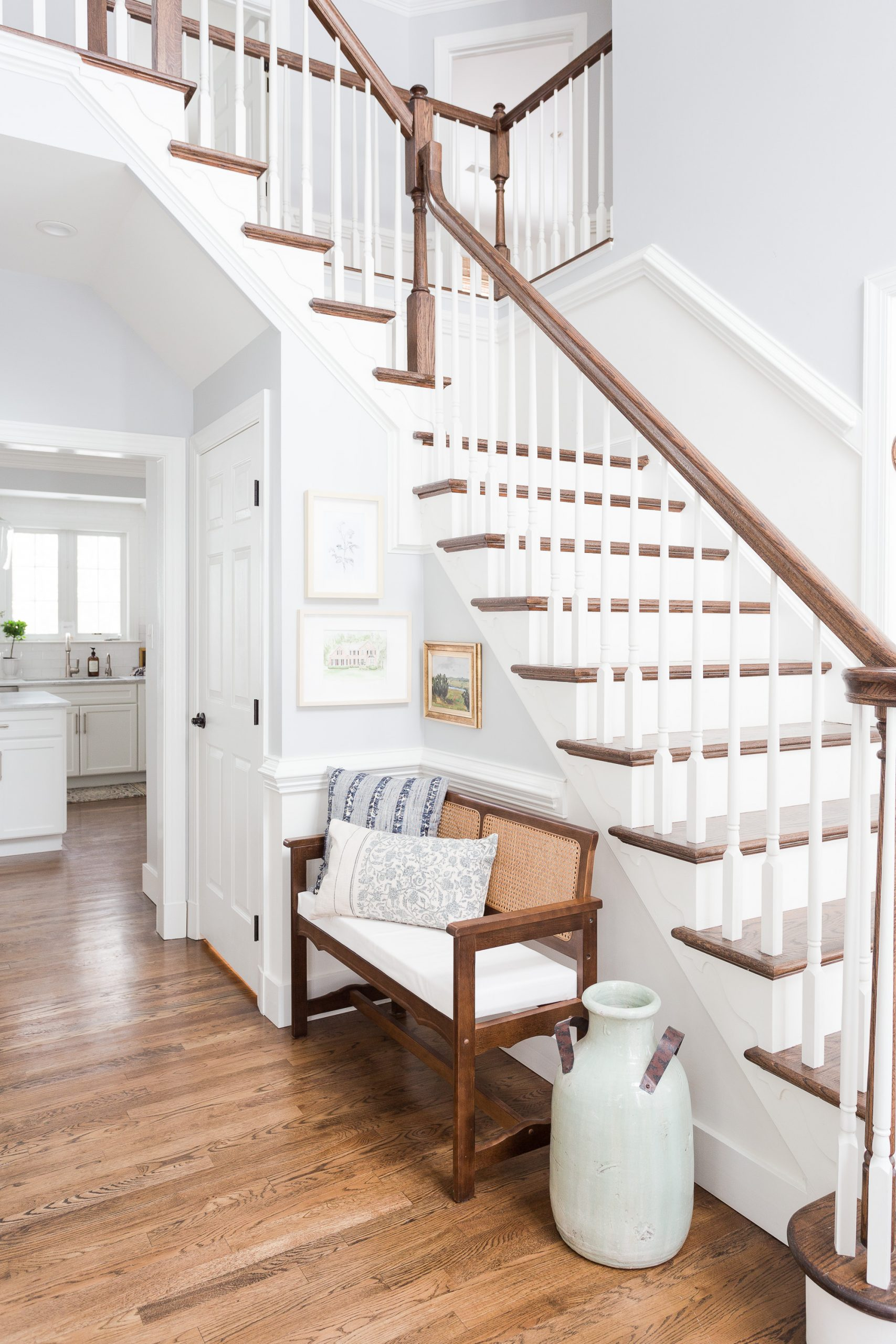 entryway of home with wood stair and white dove paint on walls